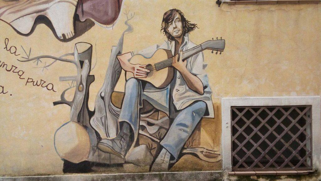 Murals depicting Fabrizio De Andrè, famous Italian singer